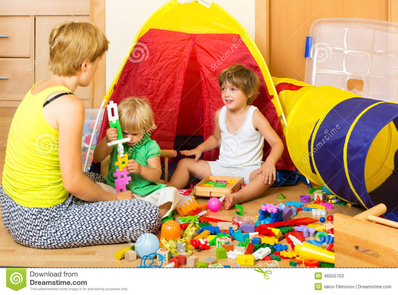Toys For Siblings : Mother and children playing stock photo image