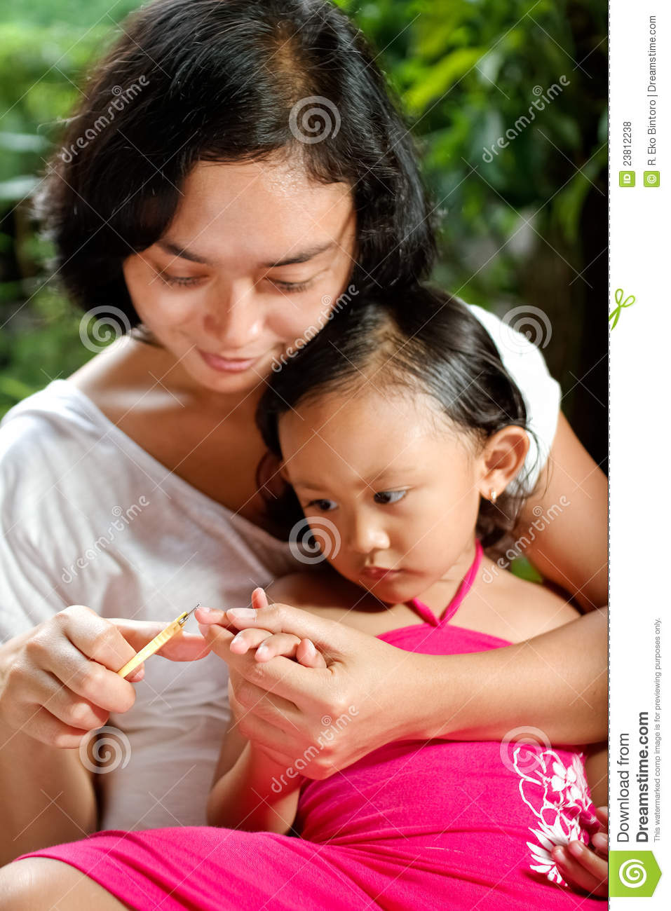 Mother Cutting Fingernail Of A Child Stock Photo Image Of Mother Family 23812238