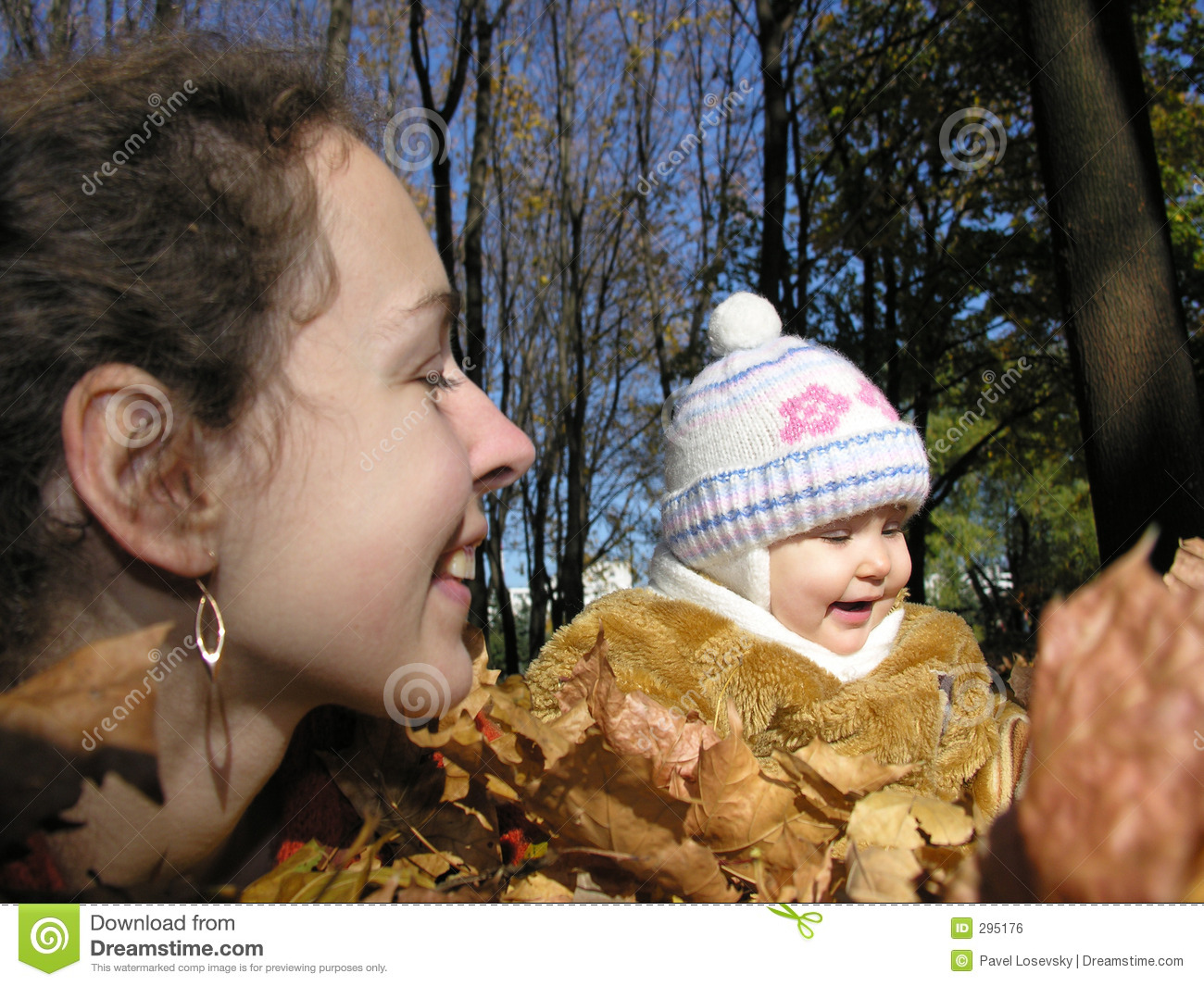 Mother with daughter in autumn wood