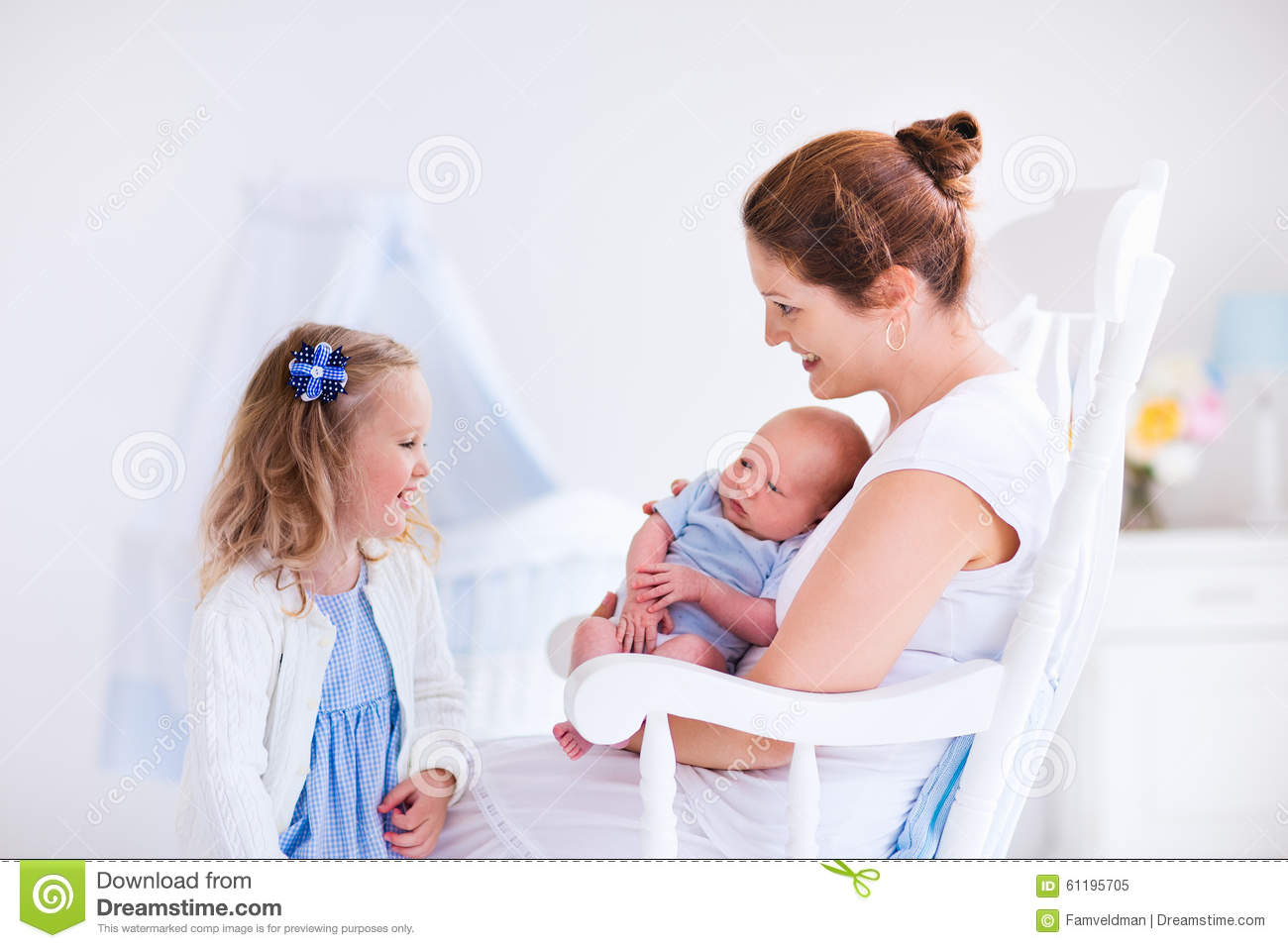 Mother With Daughter And Baby In A White Nursery Stock