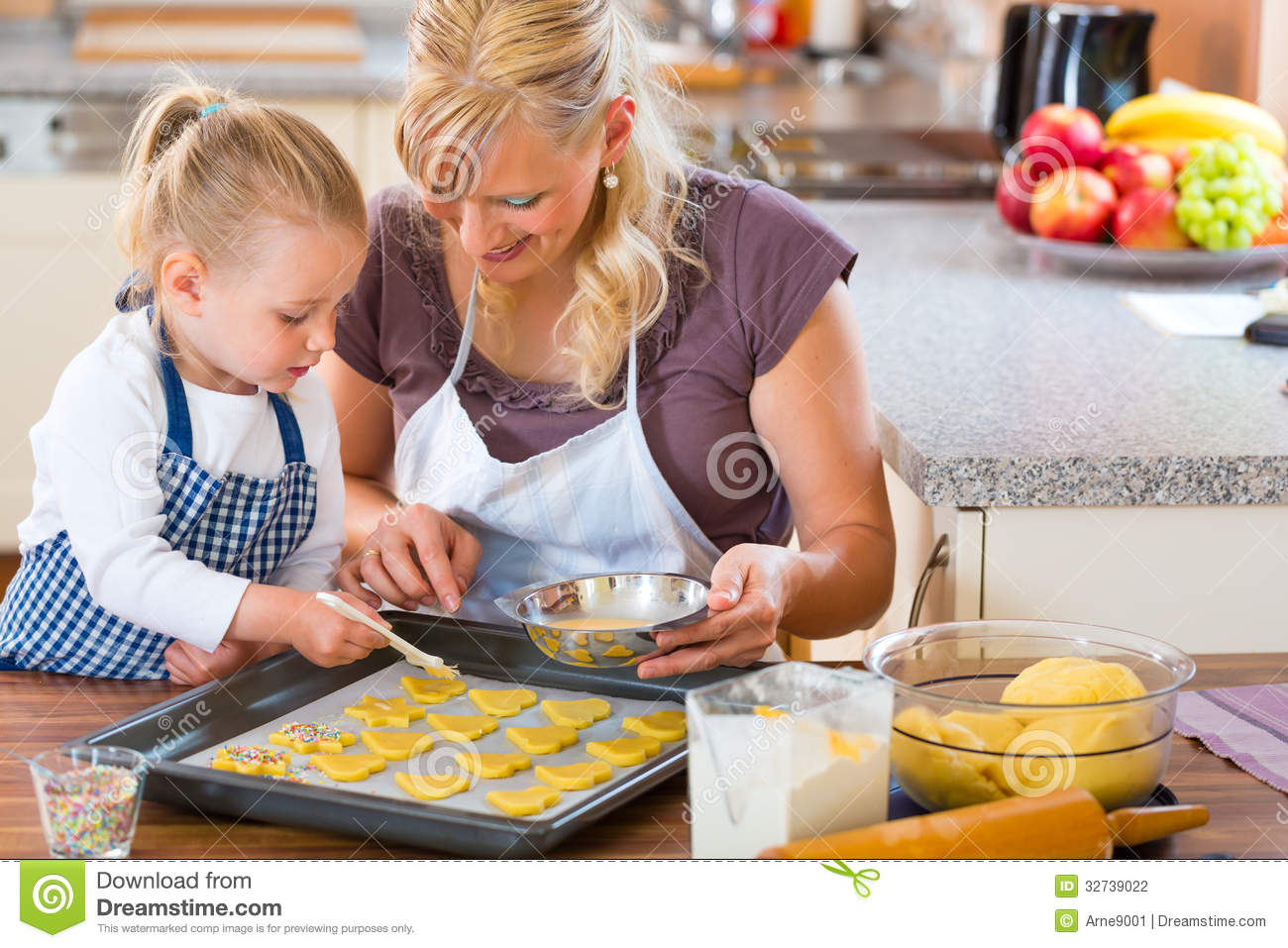Mother And Daughter Baking Cookies Together Stock ...