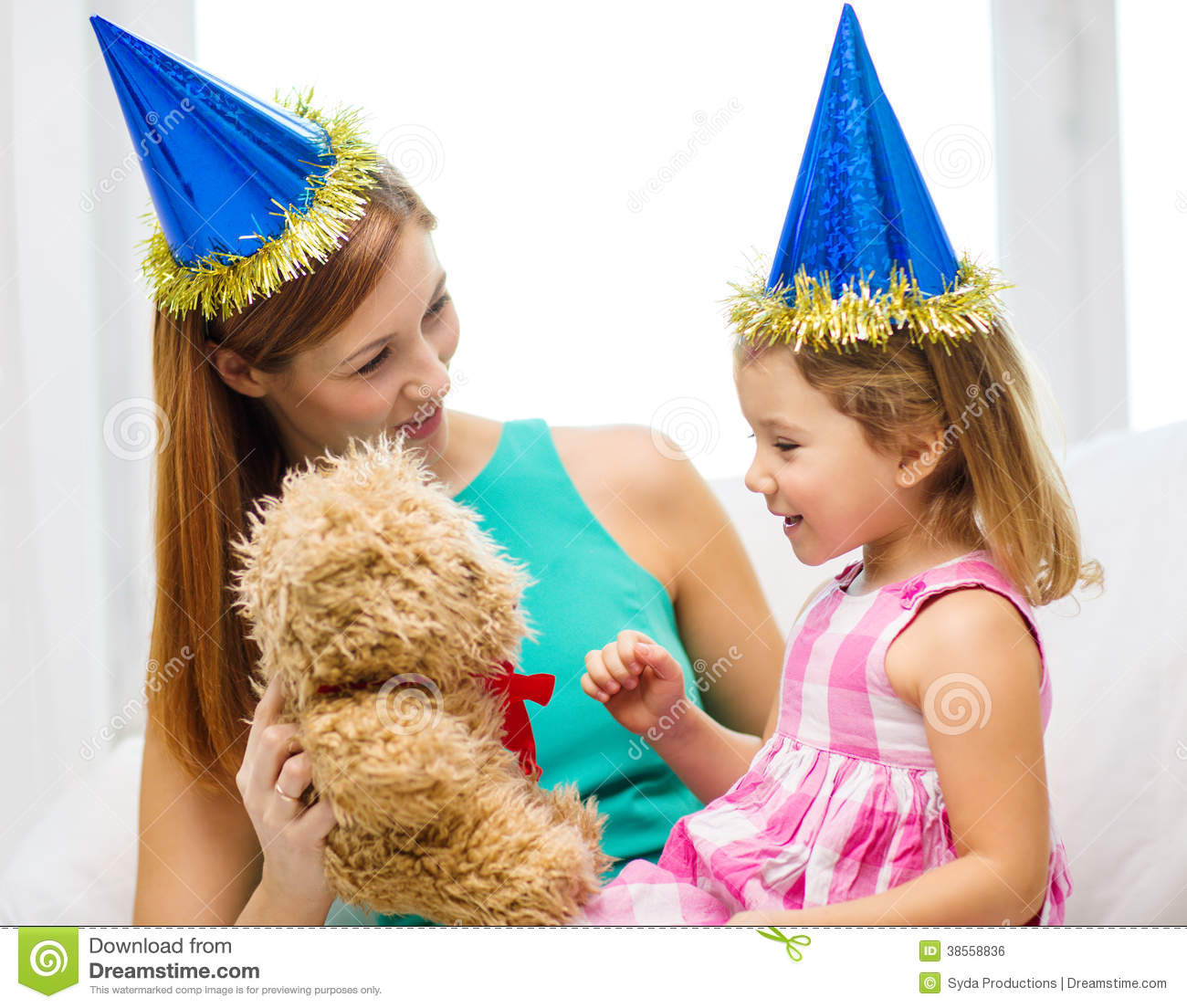 Mother And Daughter In Blue Hats With Teddy Bear Stock