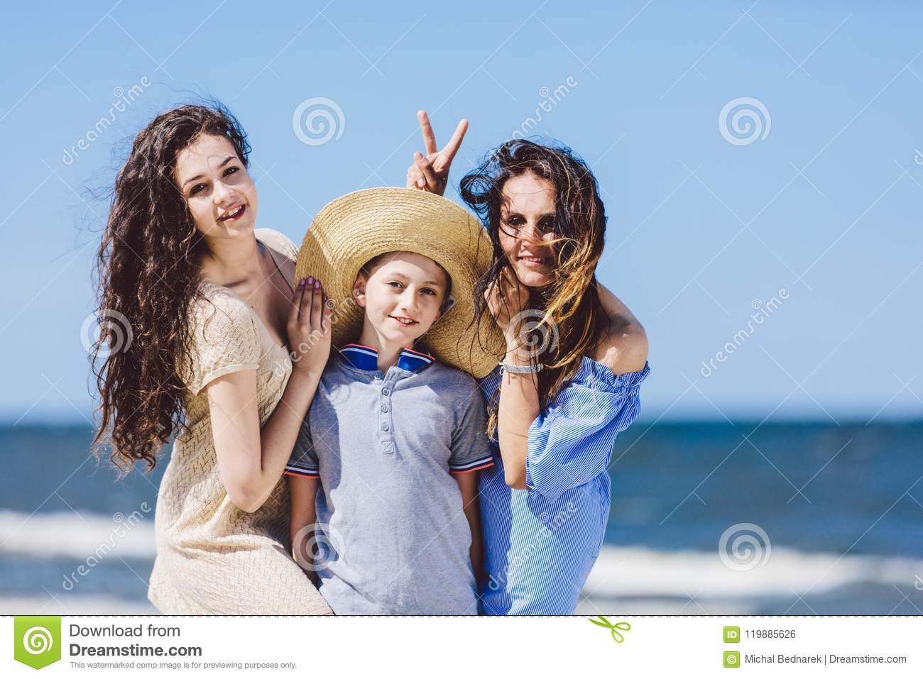 Mother Daughter And A Boy In A Straw Hat Messing Around