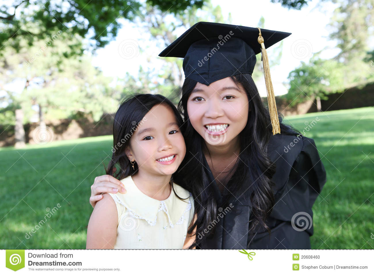 Mother And Daughter Celebrating Graduation Stock Photo