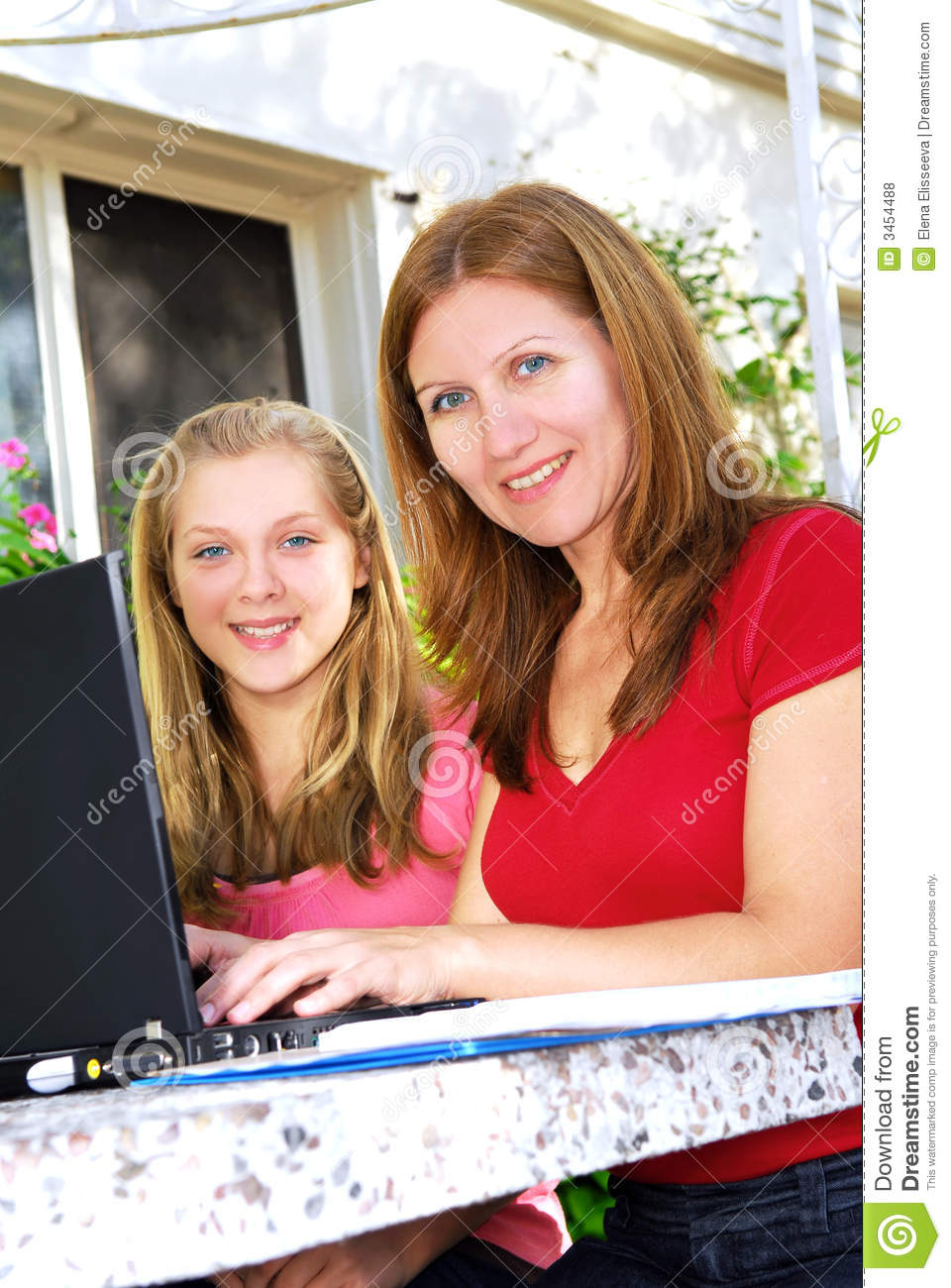 Mother and daughter with compu