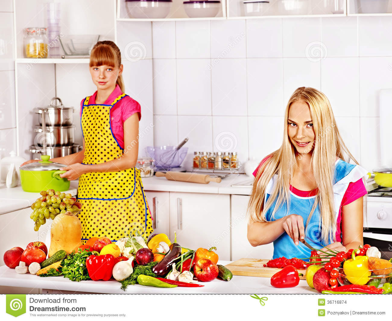 Mother With Daughter Cooking At Kitchen Royalty Free Stock Photography 49236983