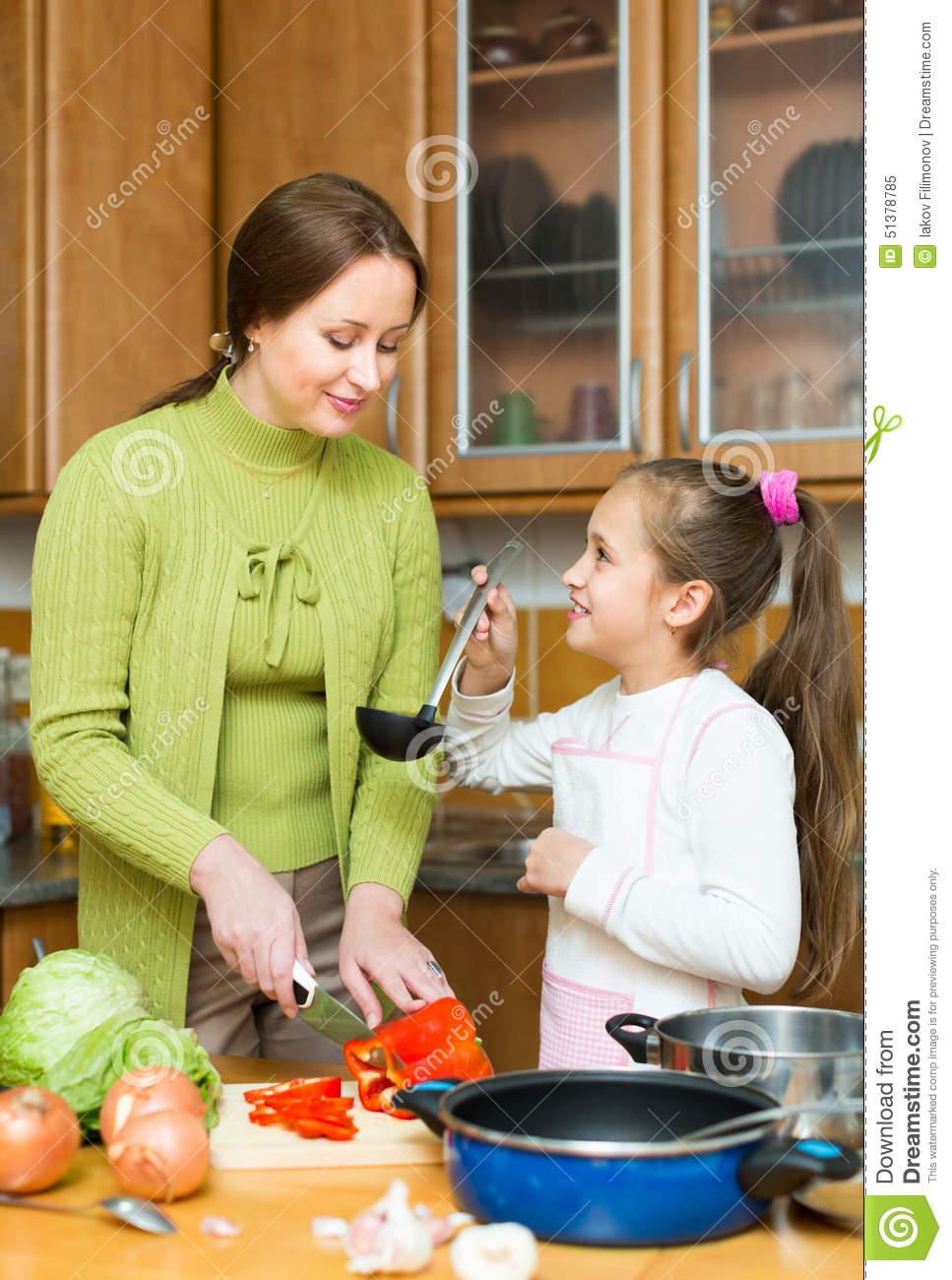 Mother With Daughter Cooking At Kitchen Stock Photo Image 51378785