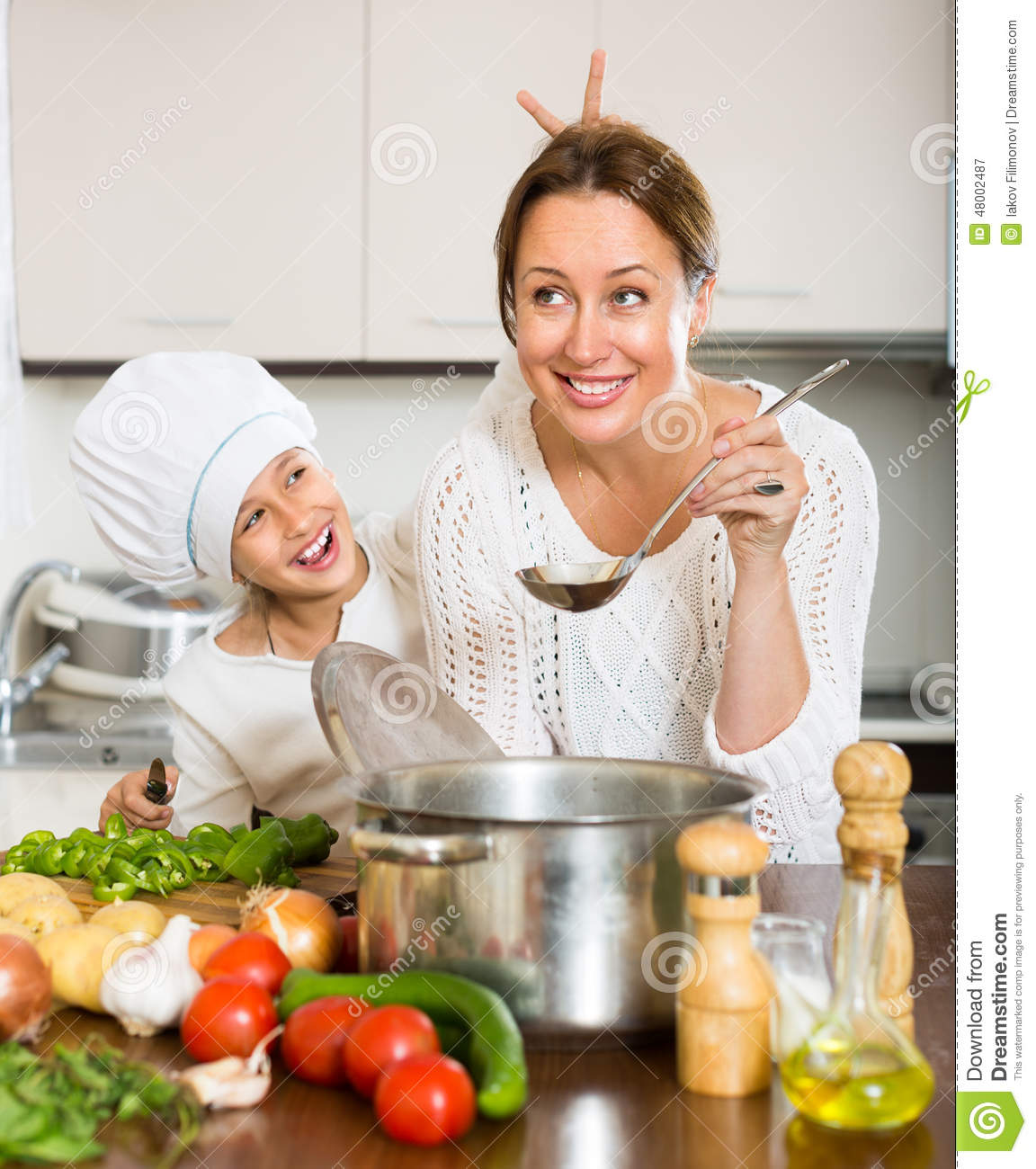 Mother And Daughter Cooking Together Stock Photo Image 48002487