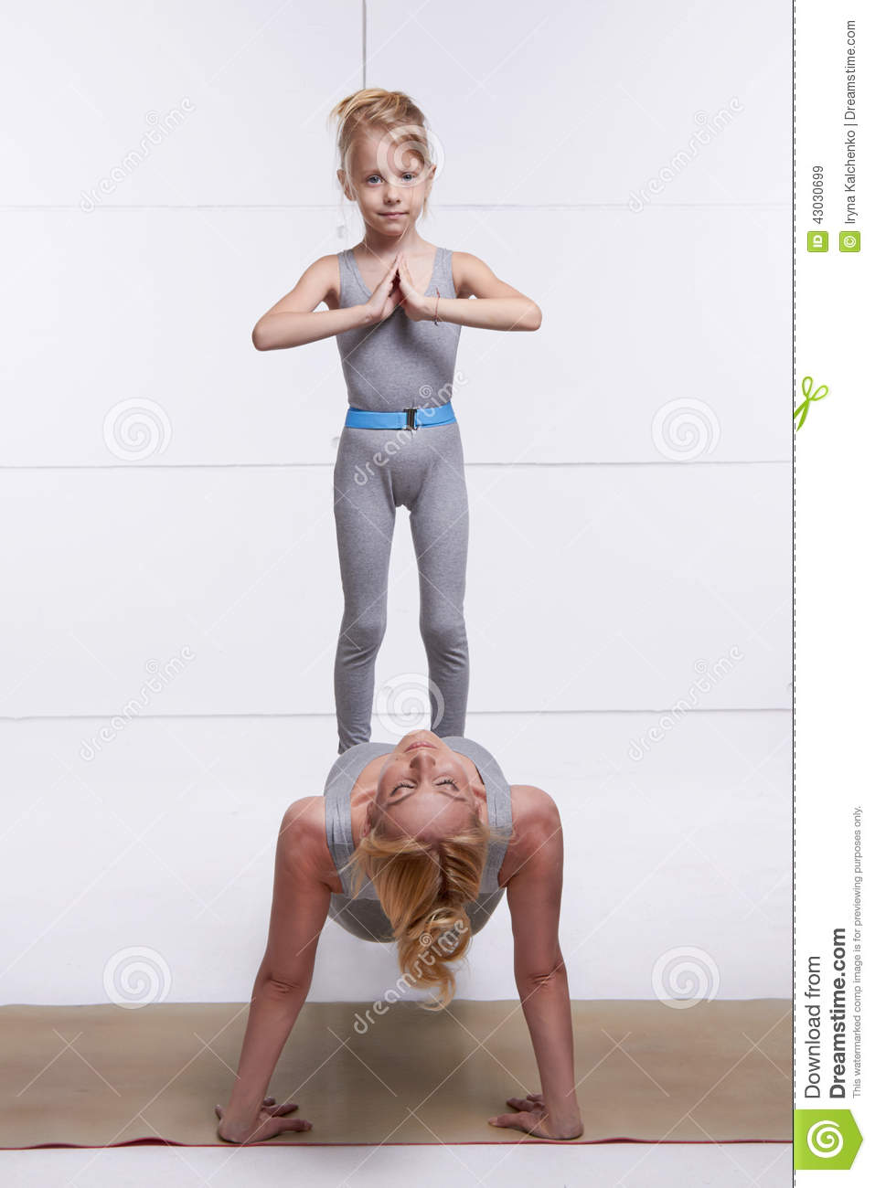 Mother And Daughter Doing Yoga Exercise, Fitness, Gym ...