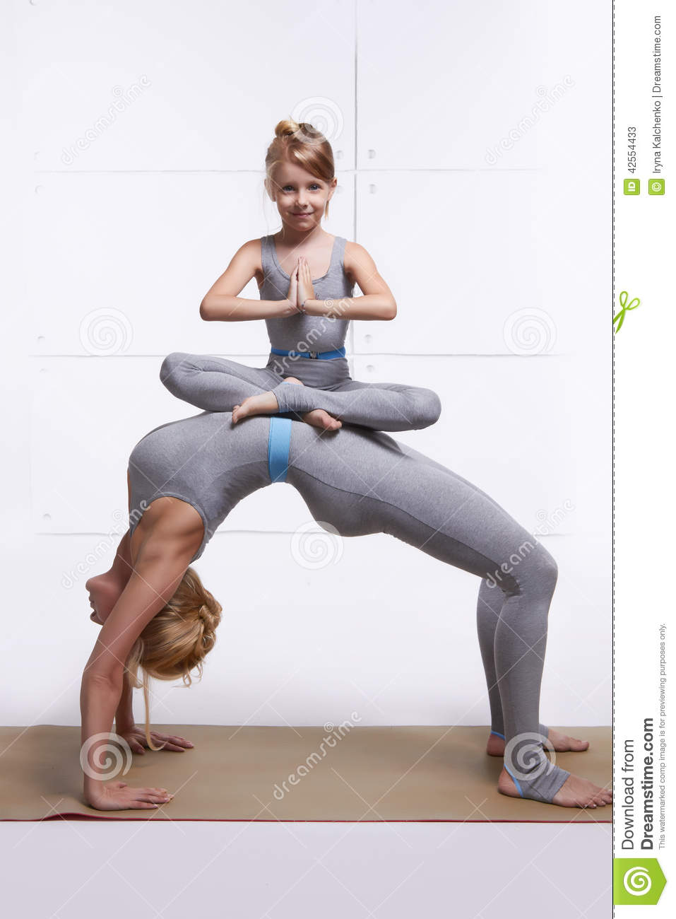 Mother Daughter Doing Yoga Exercise Fitness Gym Wearing