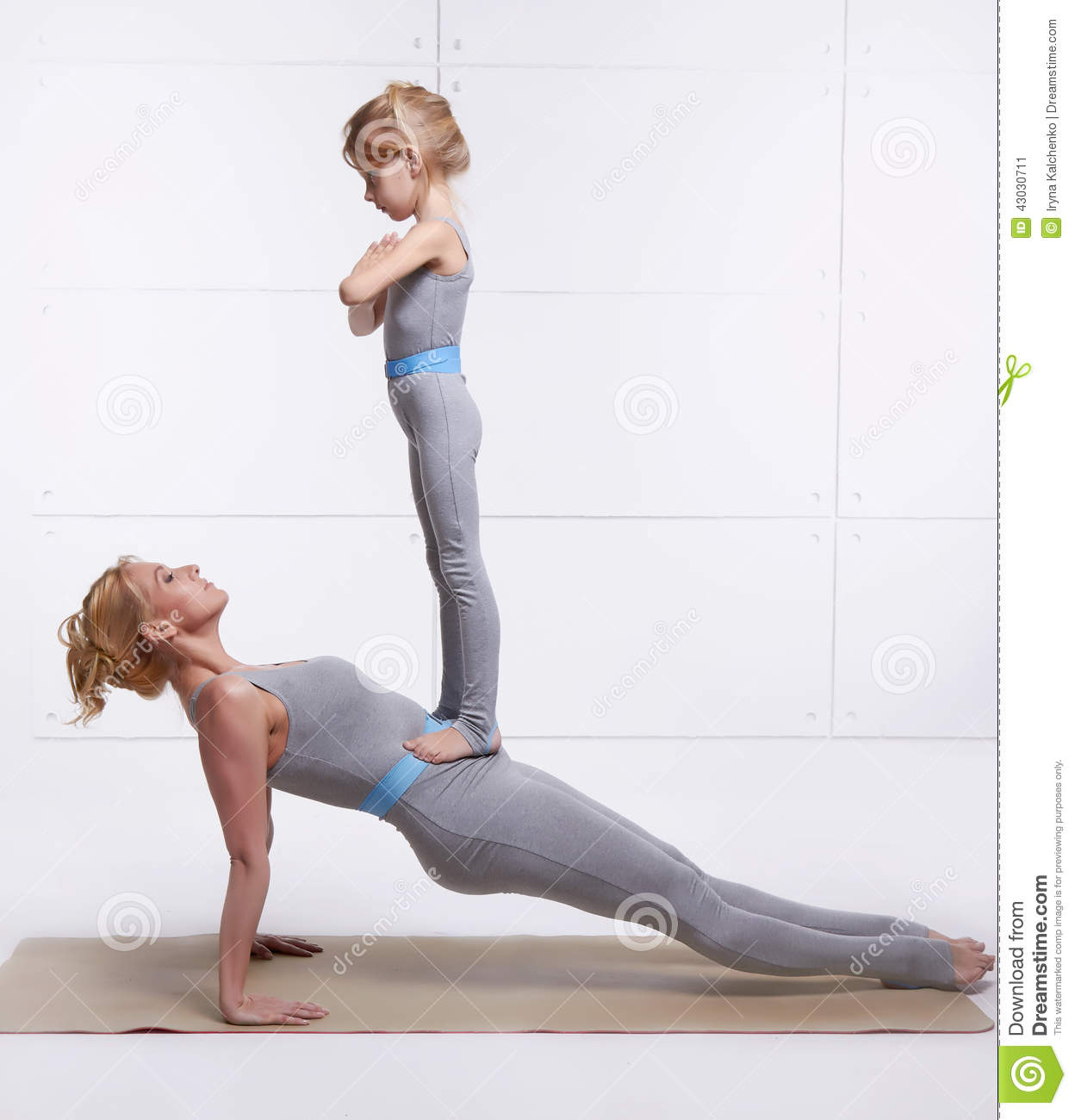 mother and daughter doing yoga exercise fitness gym. Black Bedroom Furniture Sets. Home Design Ideas