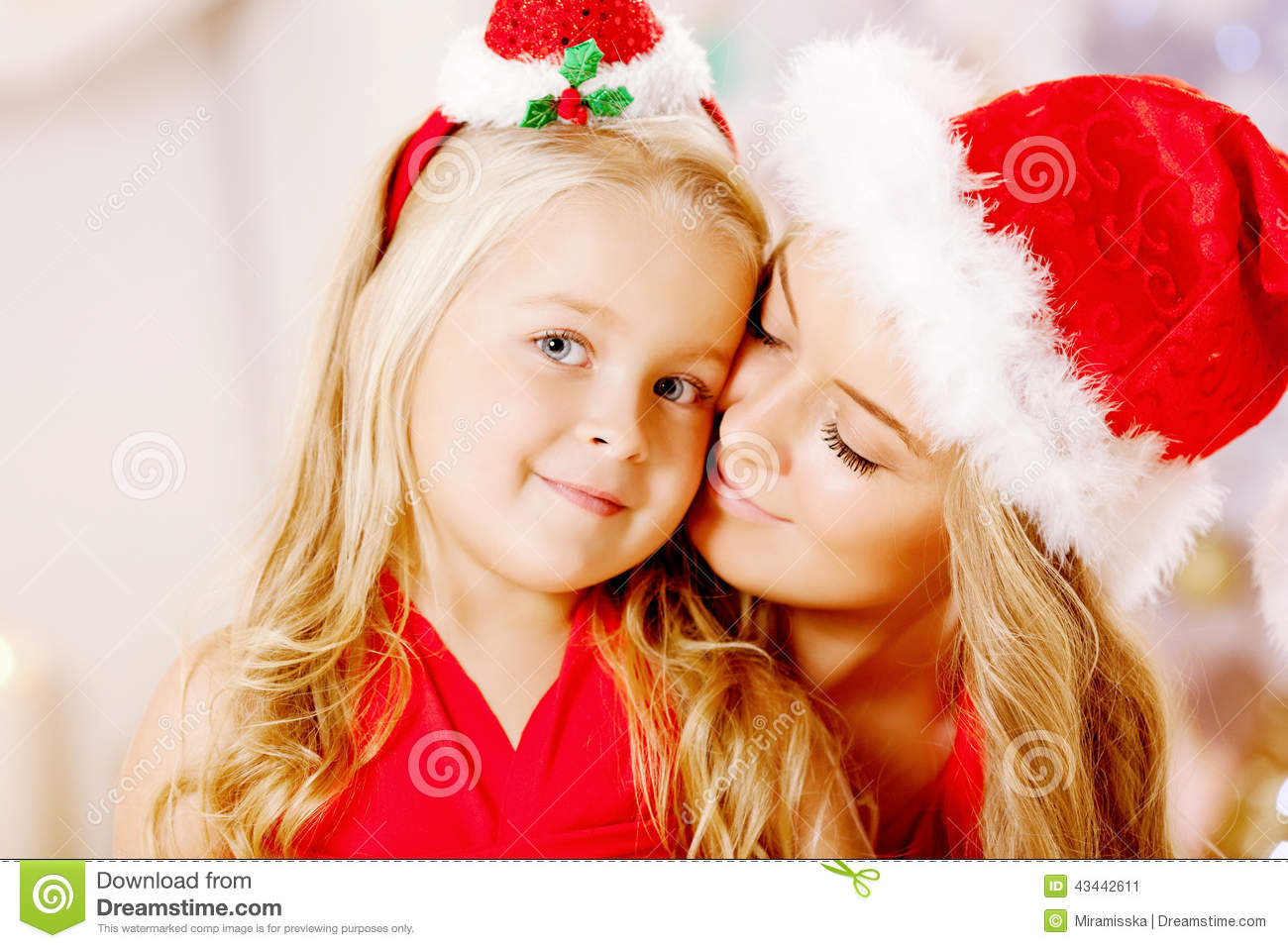 Mother And Daughter Dressed As Santa Celebrate Christmas ...