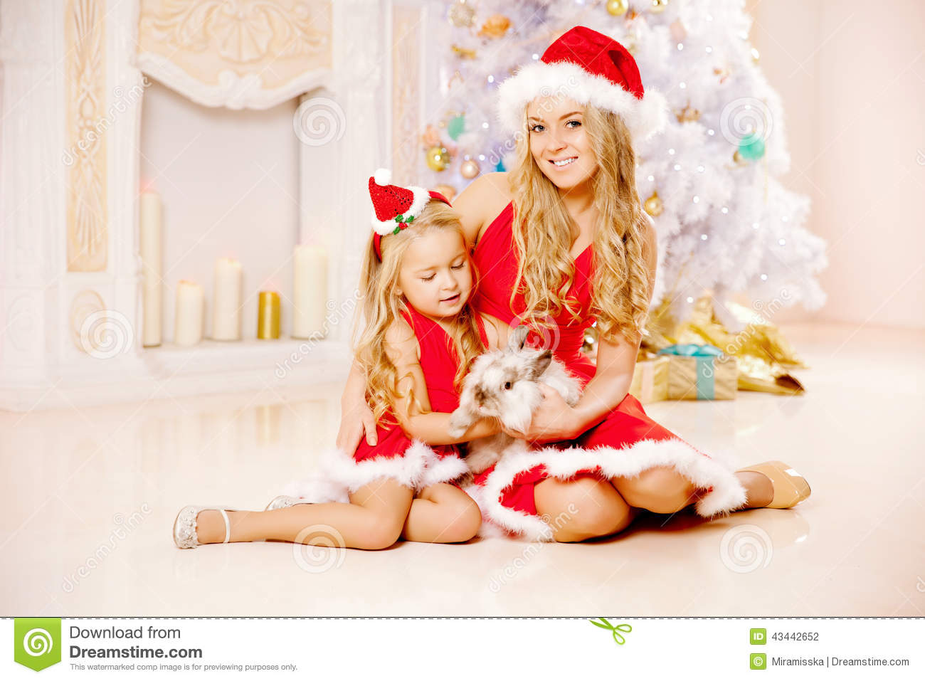 Mom And Daughter Dressed As Santa Celebrate Christmas. Stock Photo ...