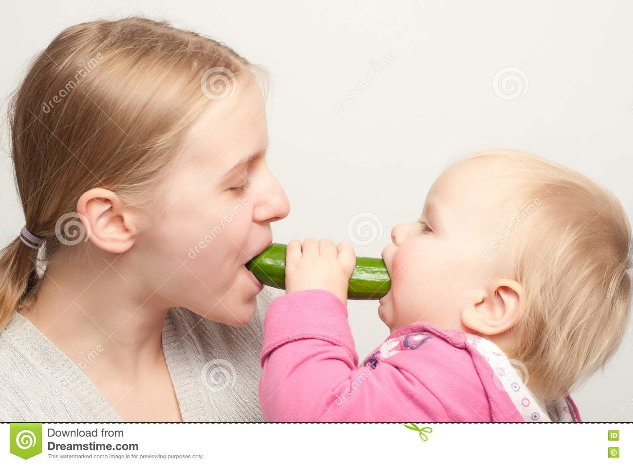 Mother With Daughter Eat Cucumber Stock Photos - Image: 16748293
