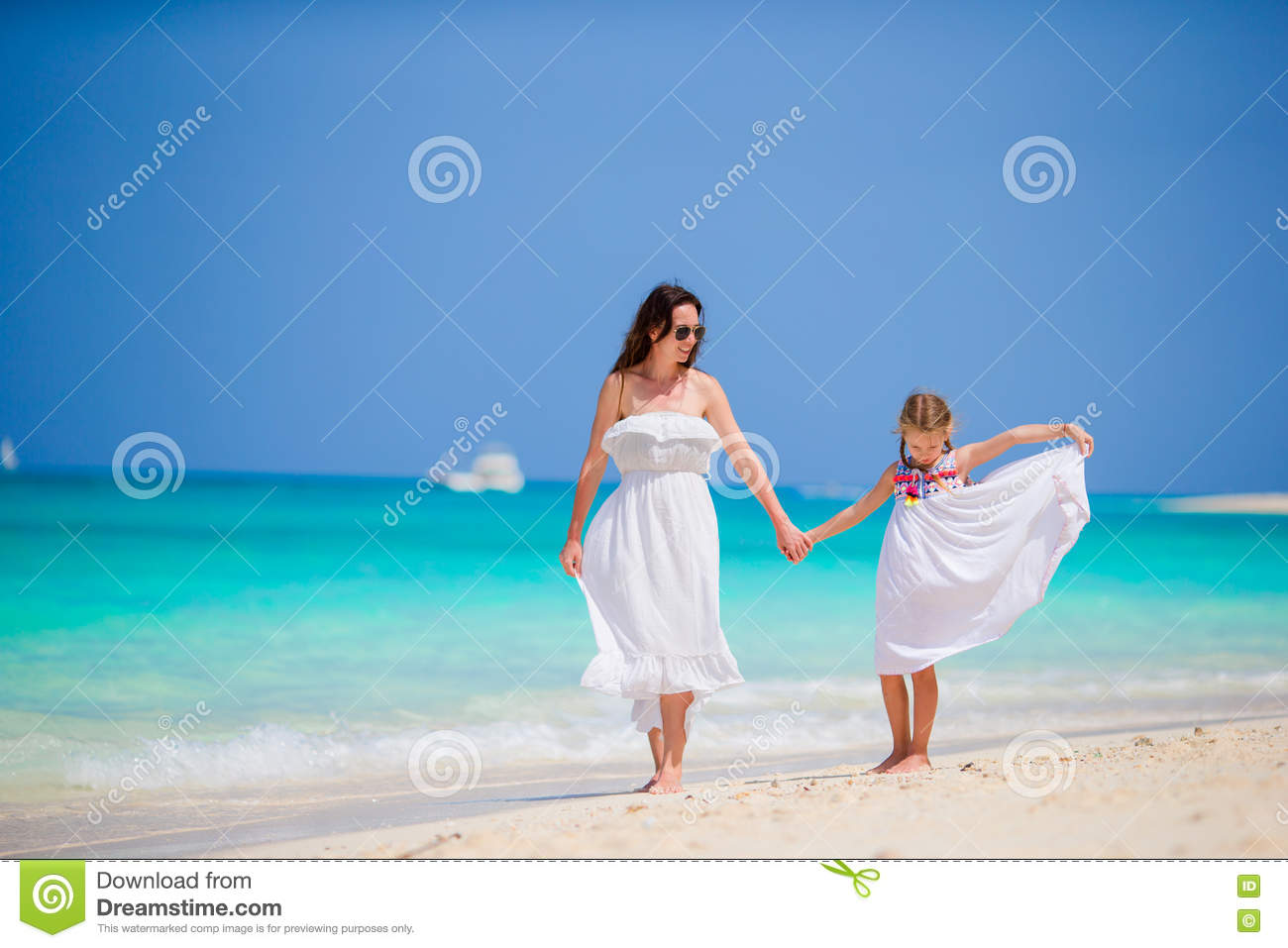 65376e0d074fd Mother and daughter enjoying time at tropical beach. Happy family on summer  holidays at exotic