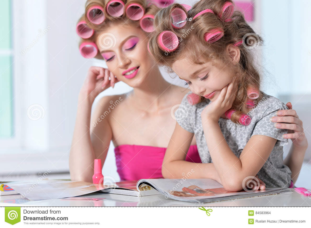 Mother And Little Daughter In Hair Curlers Royalty Free