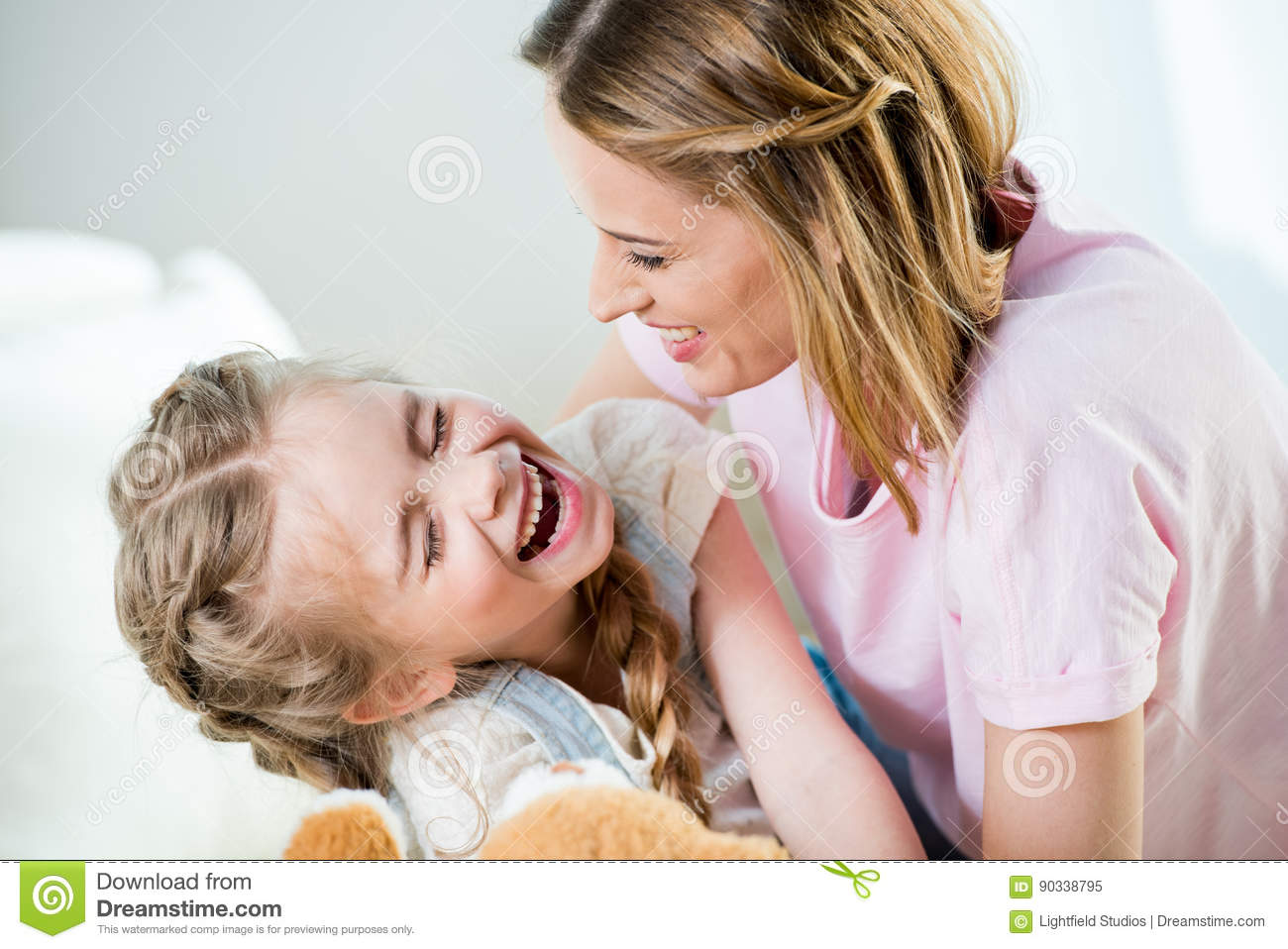 Mom and daughter having fun not