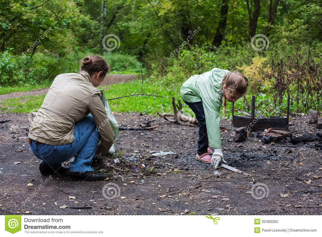Mother and daughter helping clean up the forest