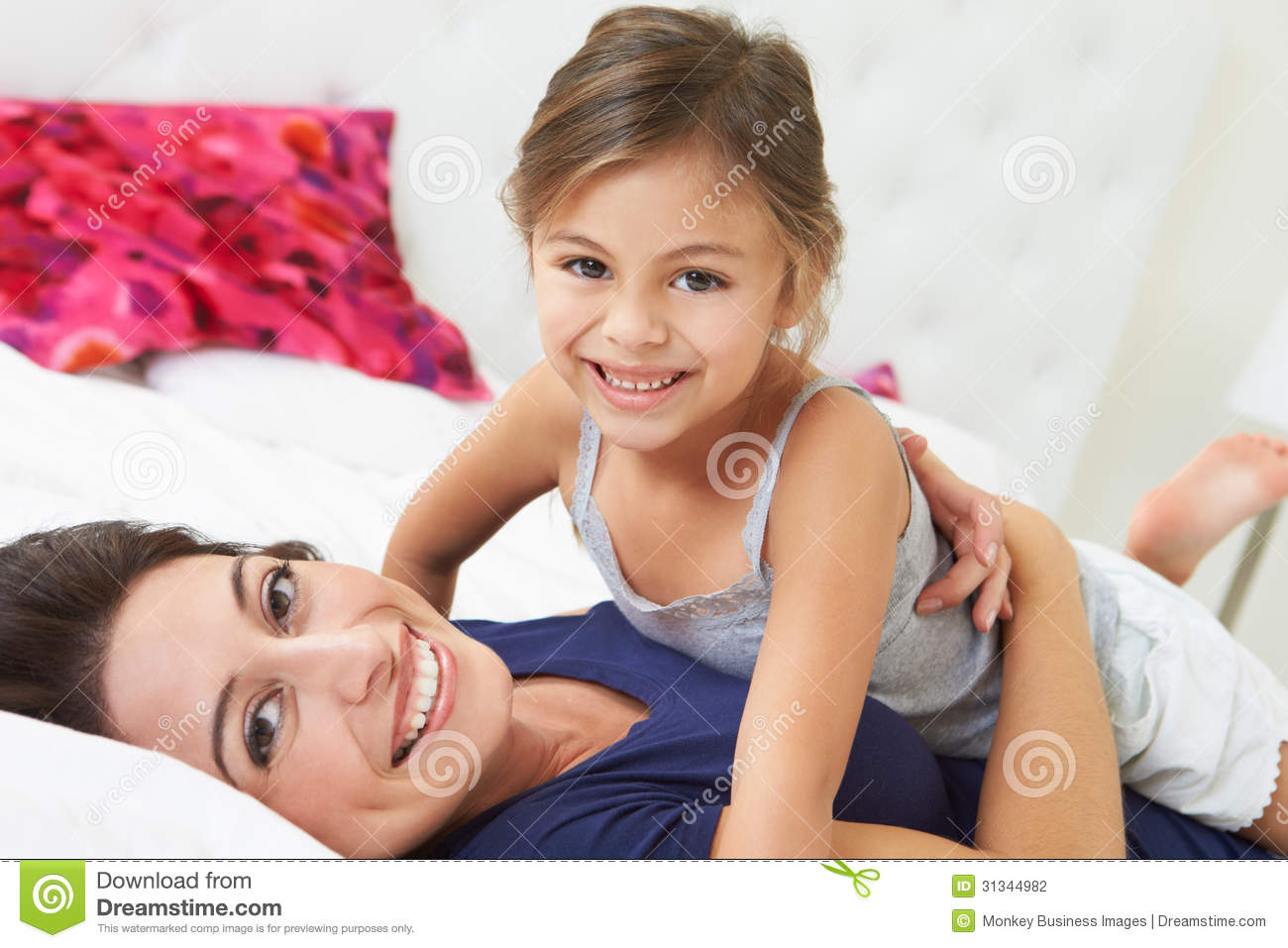 Mother And Daughter Lying In Bed Together Stock Photography Image 31344982
