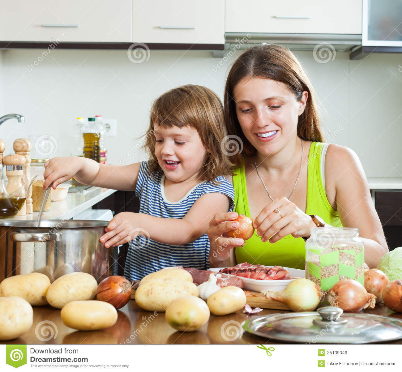 Mother With Daughter Making Soup Royalty Free Stock Images Image 35139349