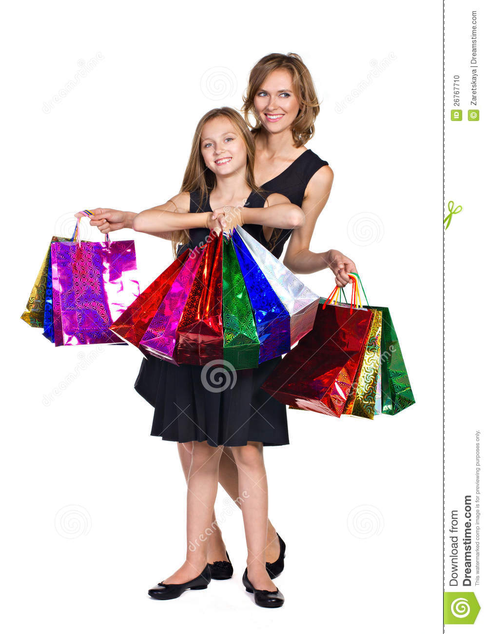Mother and daughter with many colorful bags