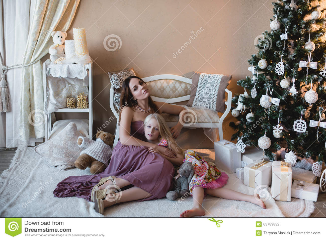 Mother With Daughter Near The Christmas Tree Royalty Free