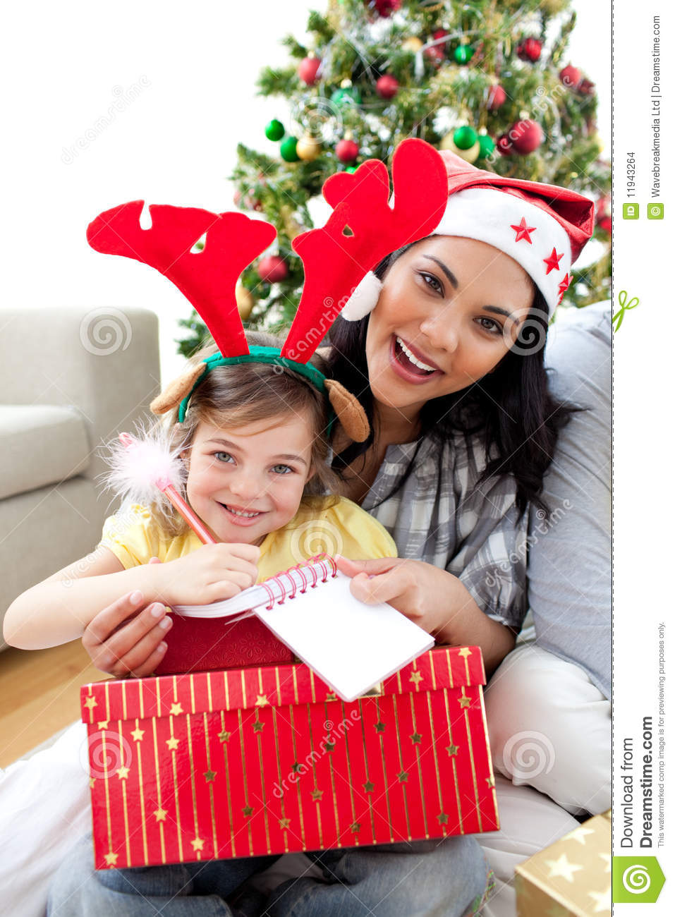Mother And Daughter Playing With Christmas Gifts Stock