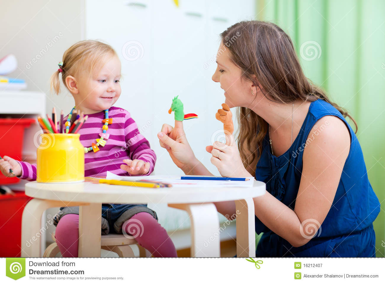 Mom Play Toys : Mother and daughter playing with finger toys royalty free