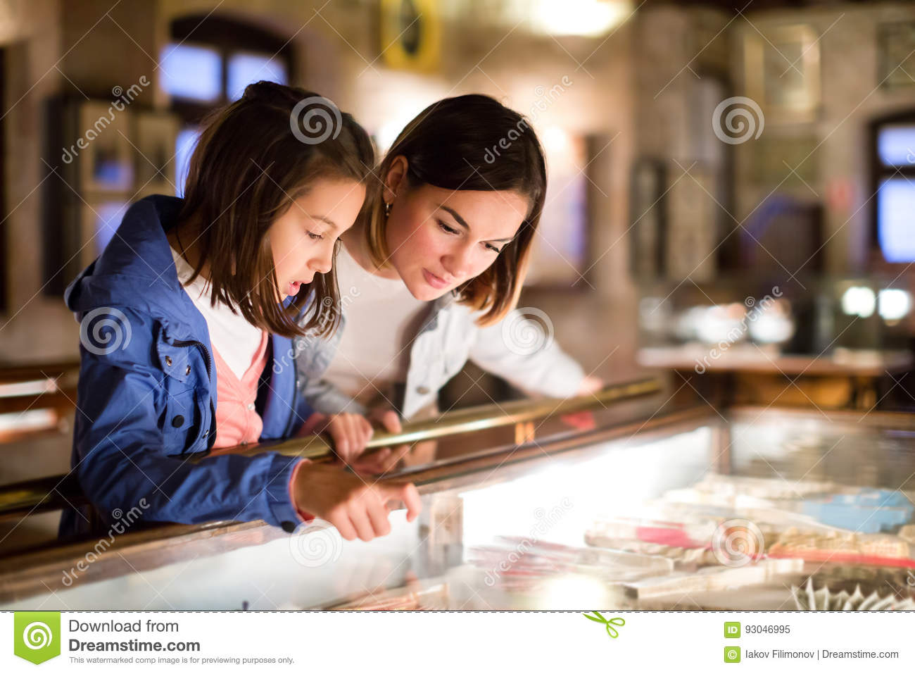 Mother and daughter pointing at sight during