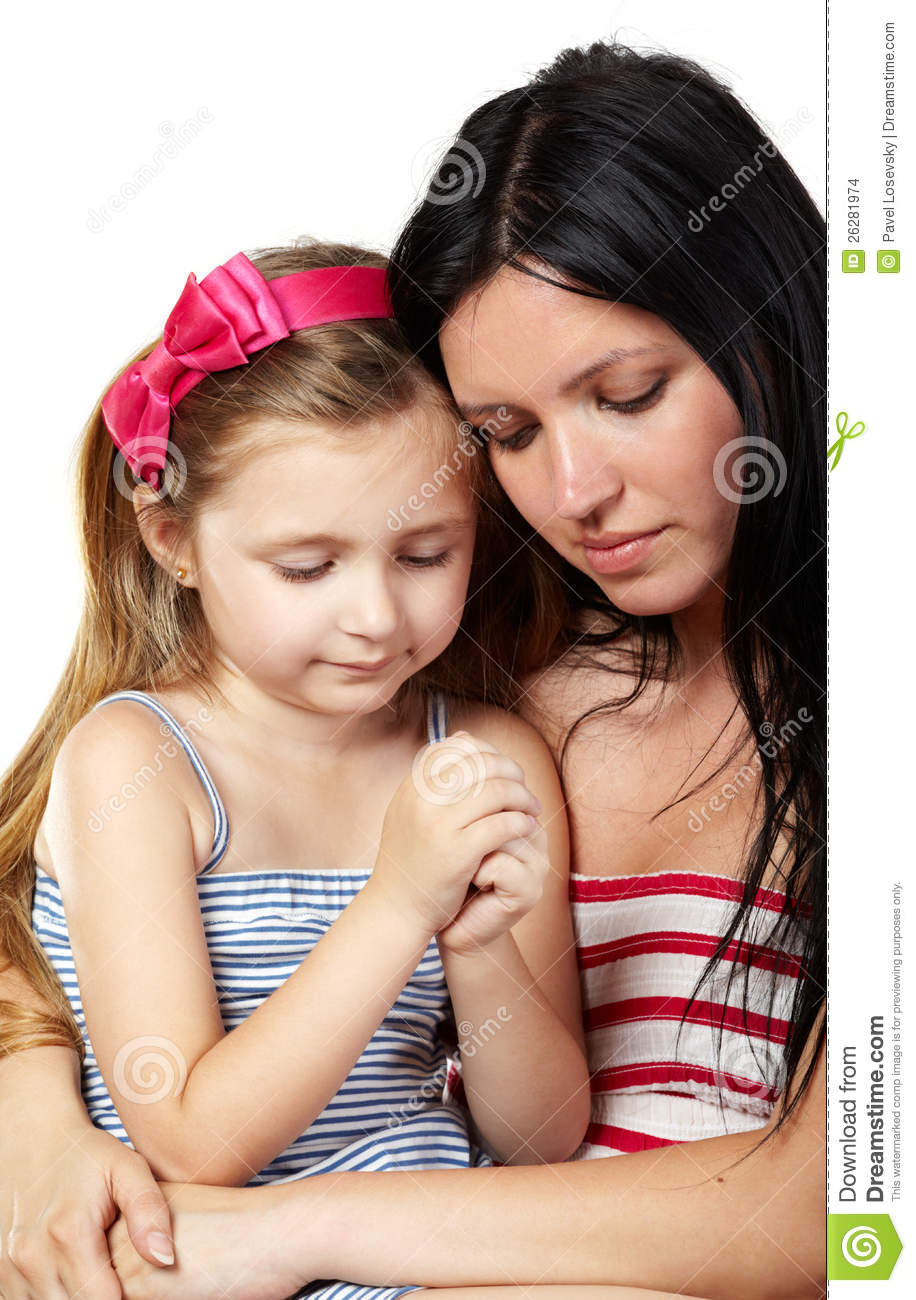 Mother and daughter pray