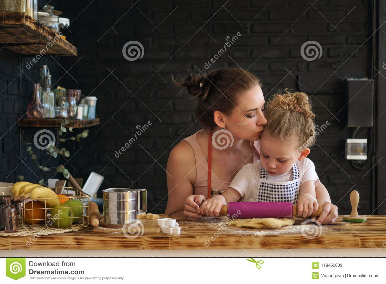 Mother and daughter prepare cookies in kitchen
