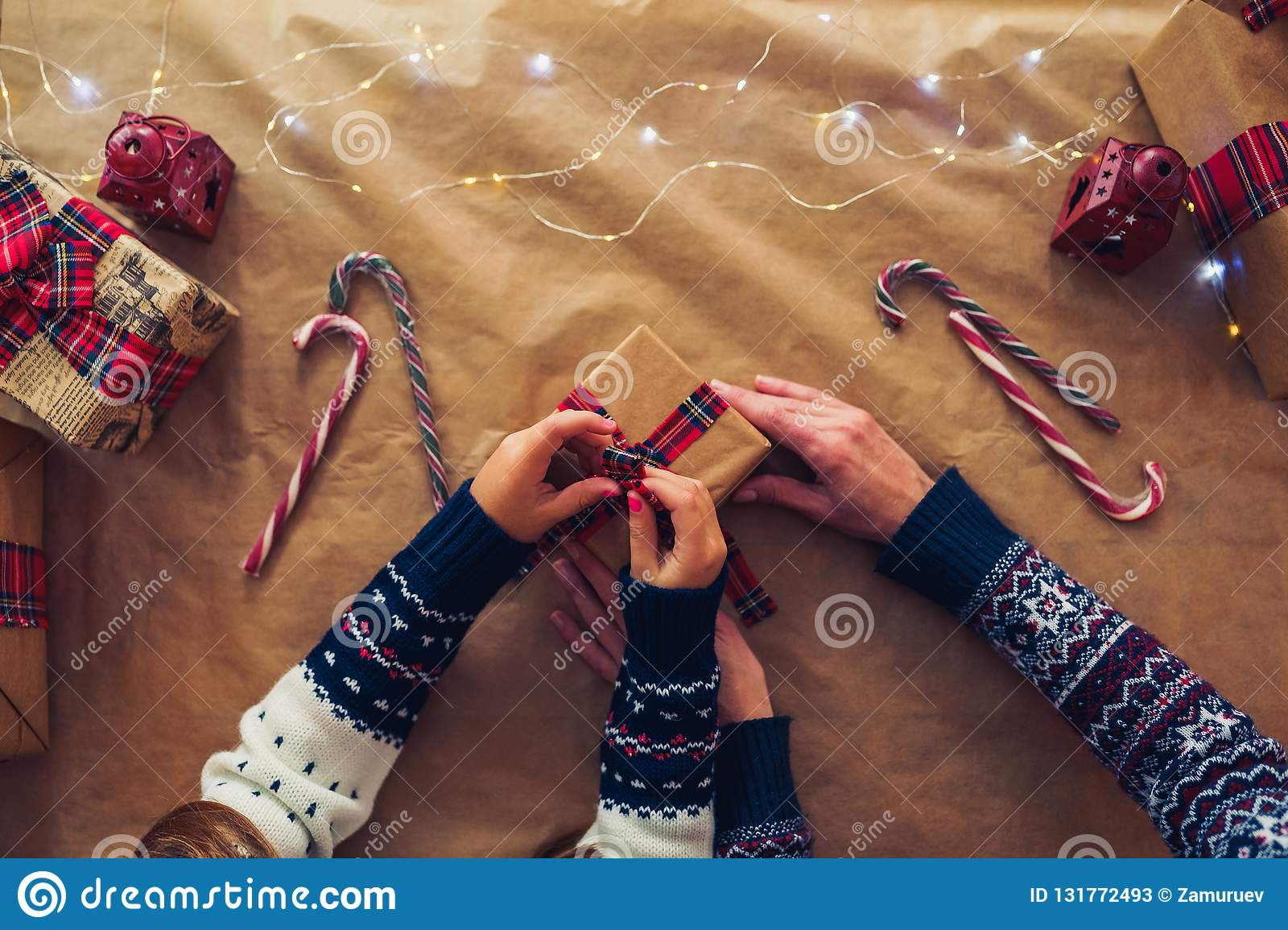 A mother and daughter prepare Xmas gifts. Top view. Christmas family traditions.