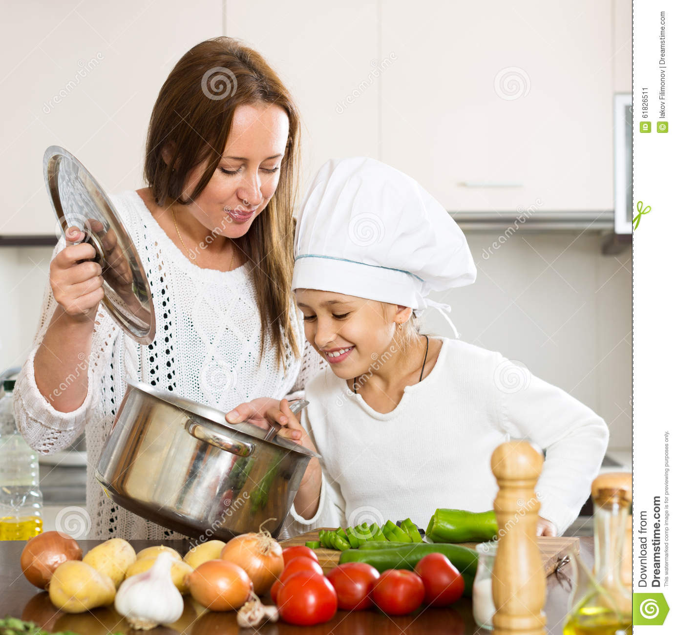 Mother And Daughter Preparing Soup Stock Photo