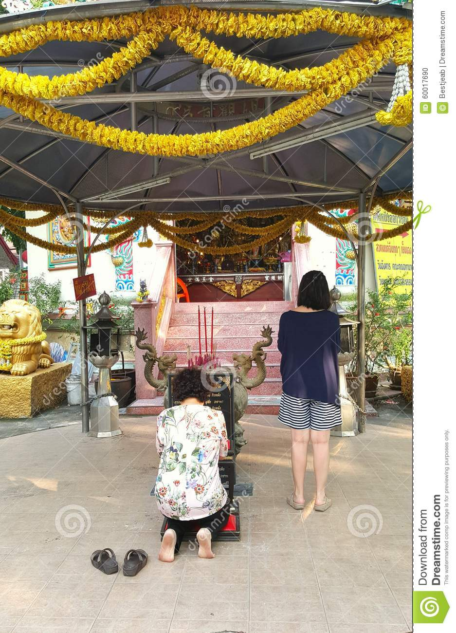 Mother and daughter pray respect to Buddha