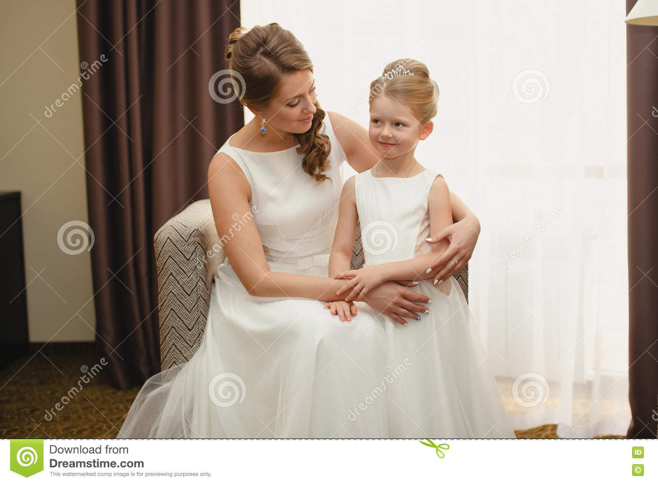 Mother and daughter in the same wedding dresses stock for Mother daughter dresses for weddings