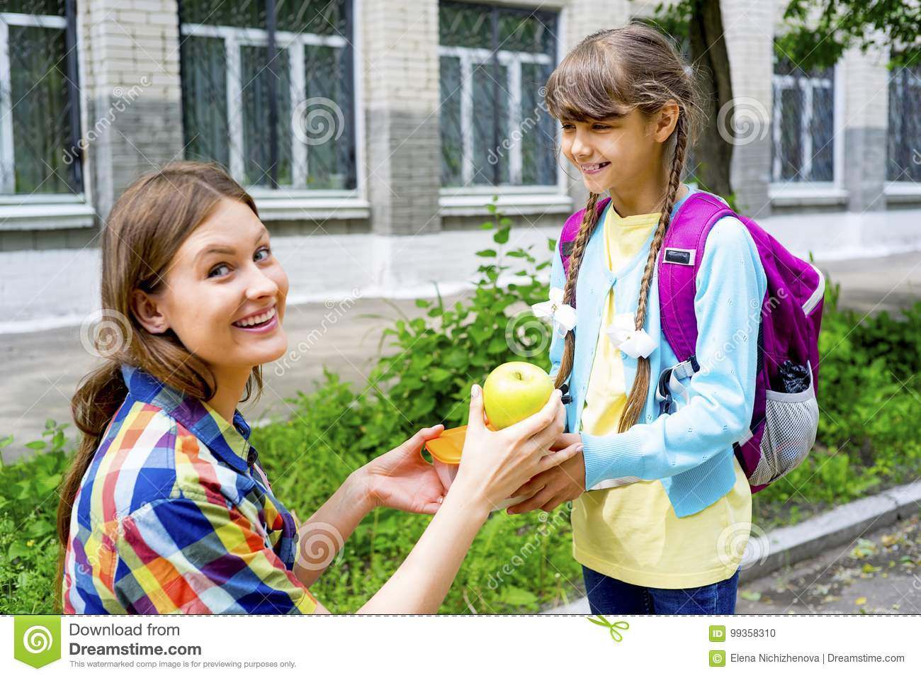 Mother And Daughter At School Stock Photo - Image of