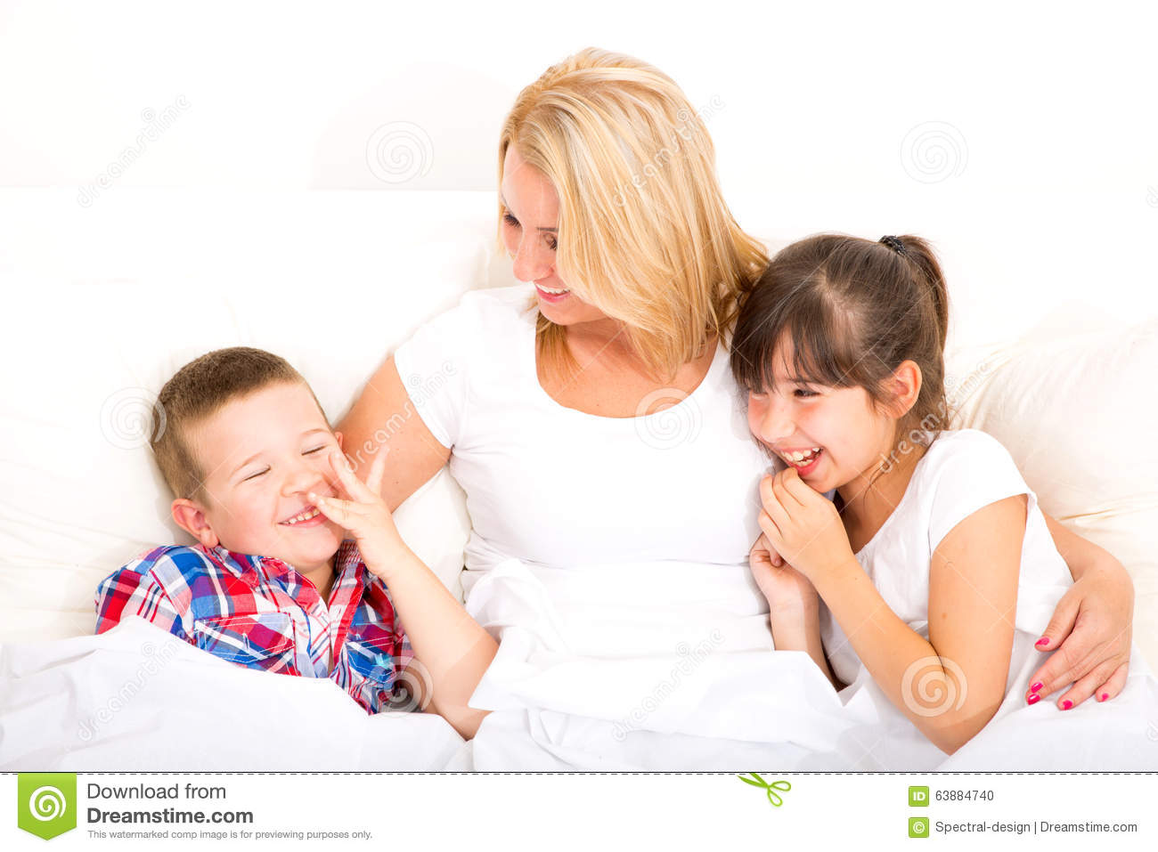 mother with daughter and son relaxing in bed stock photo image 63884740. Black Bedroom Furniture Sets. Home Design Ideas