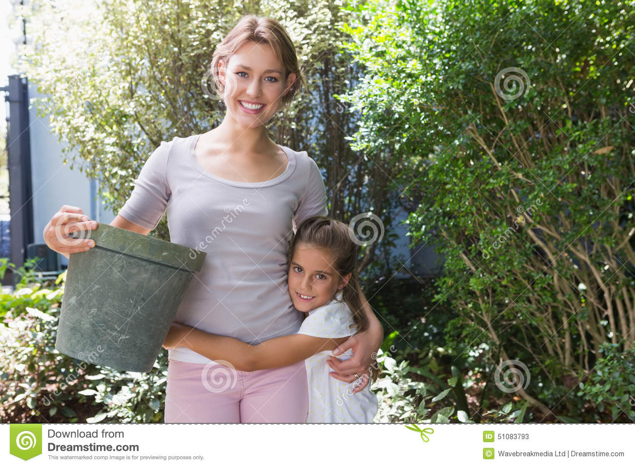 Mother and daughter tending to flowers stock image image of hobby happy 51083793 for Tending to the garden