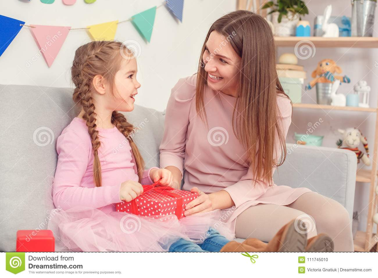 Mother And Daughter Together At Home Celebration Concept Sitting Mom Making A Gift For