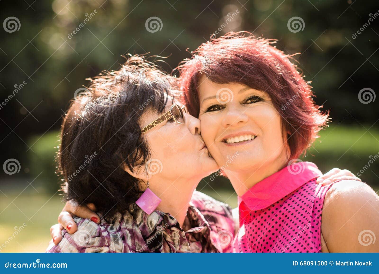 women kissing Mature women