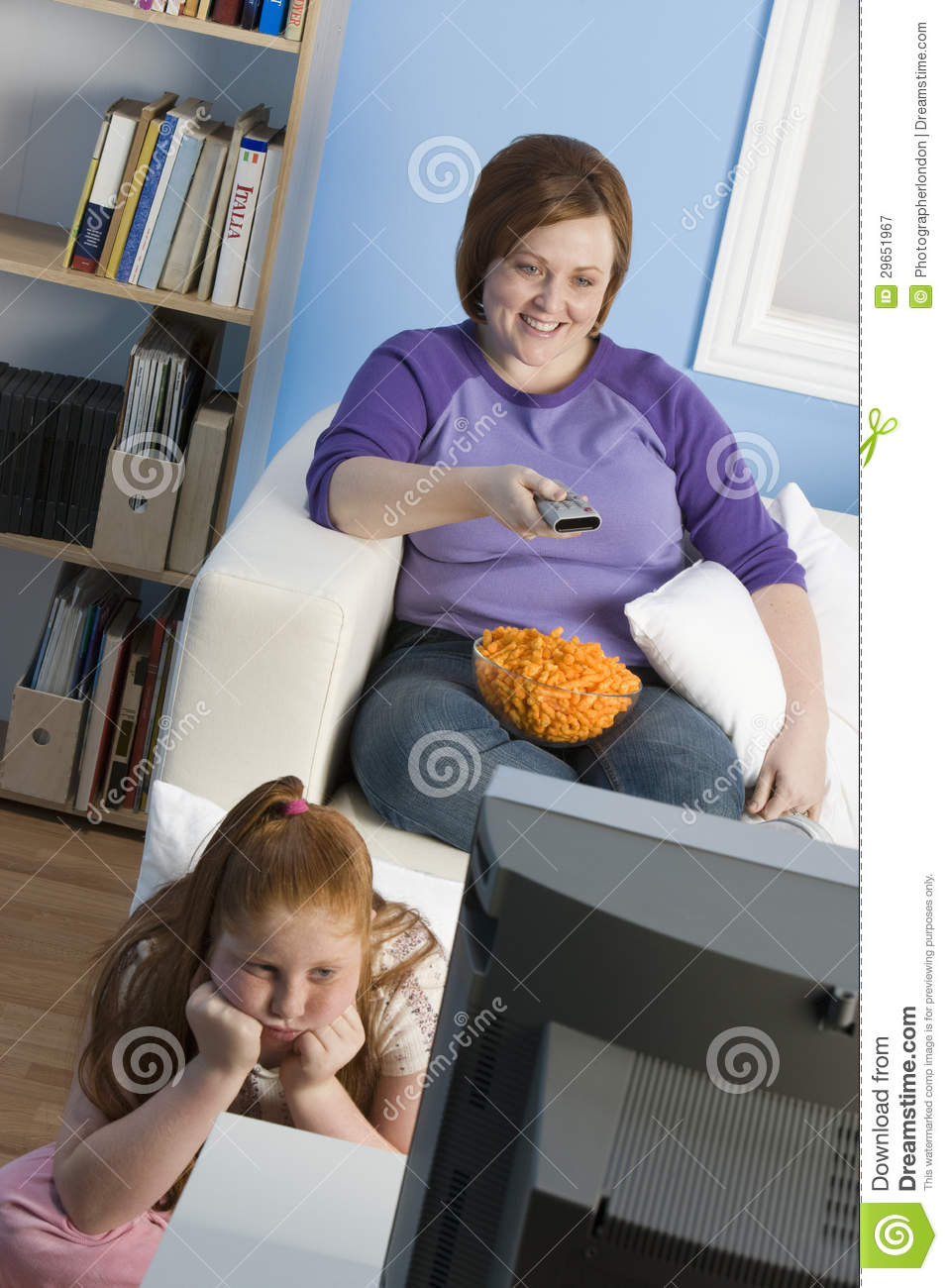 Watch Mom In Bedroom Camera: Mother And Daughter Watching Television Stock Image