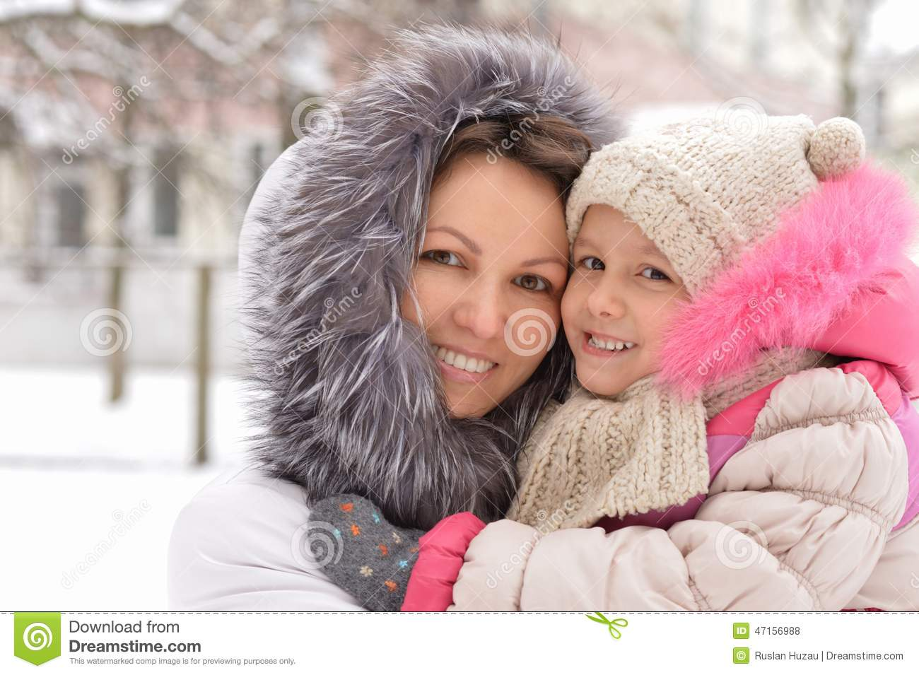 Mother and daughter in winter