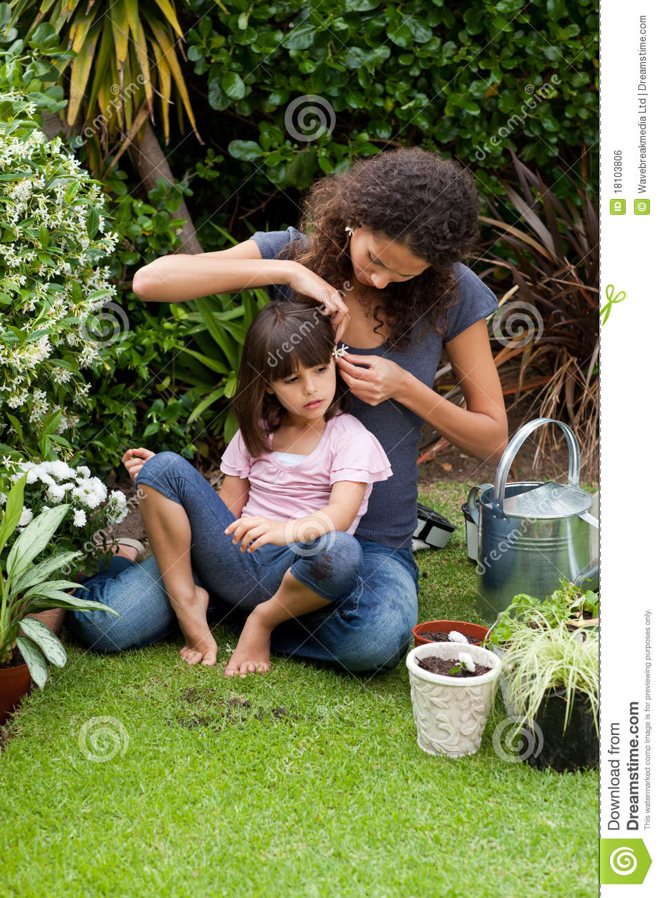 Mother And Daughter Working In The Garden Royalty Free