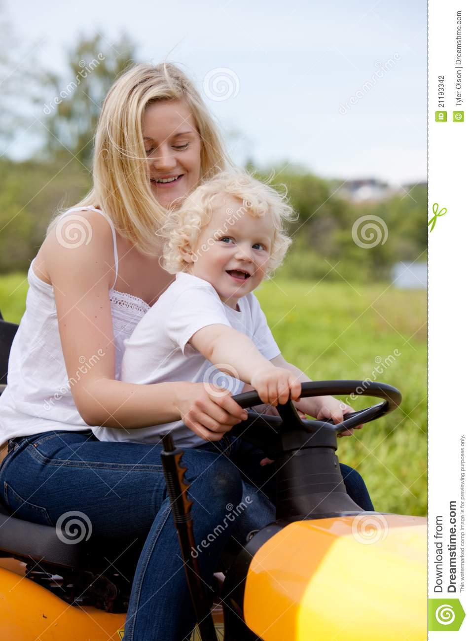 Mother Driving Tractor with Son