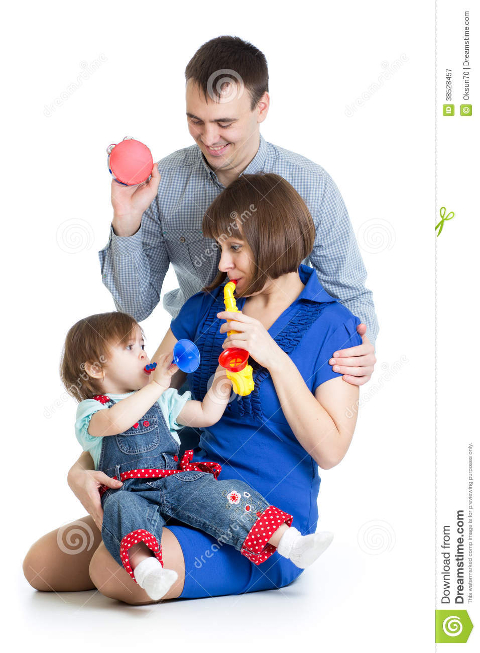 Toys For Dads : Mother father and baby girl play musical toys stock image