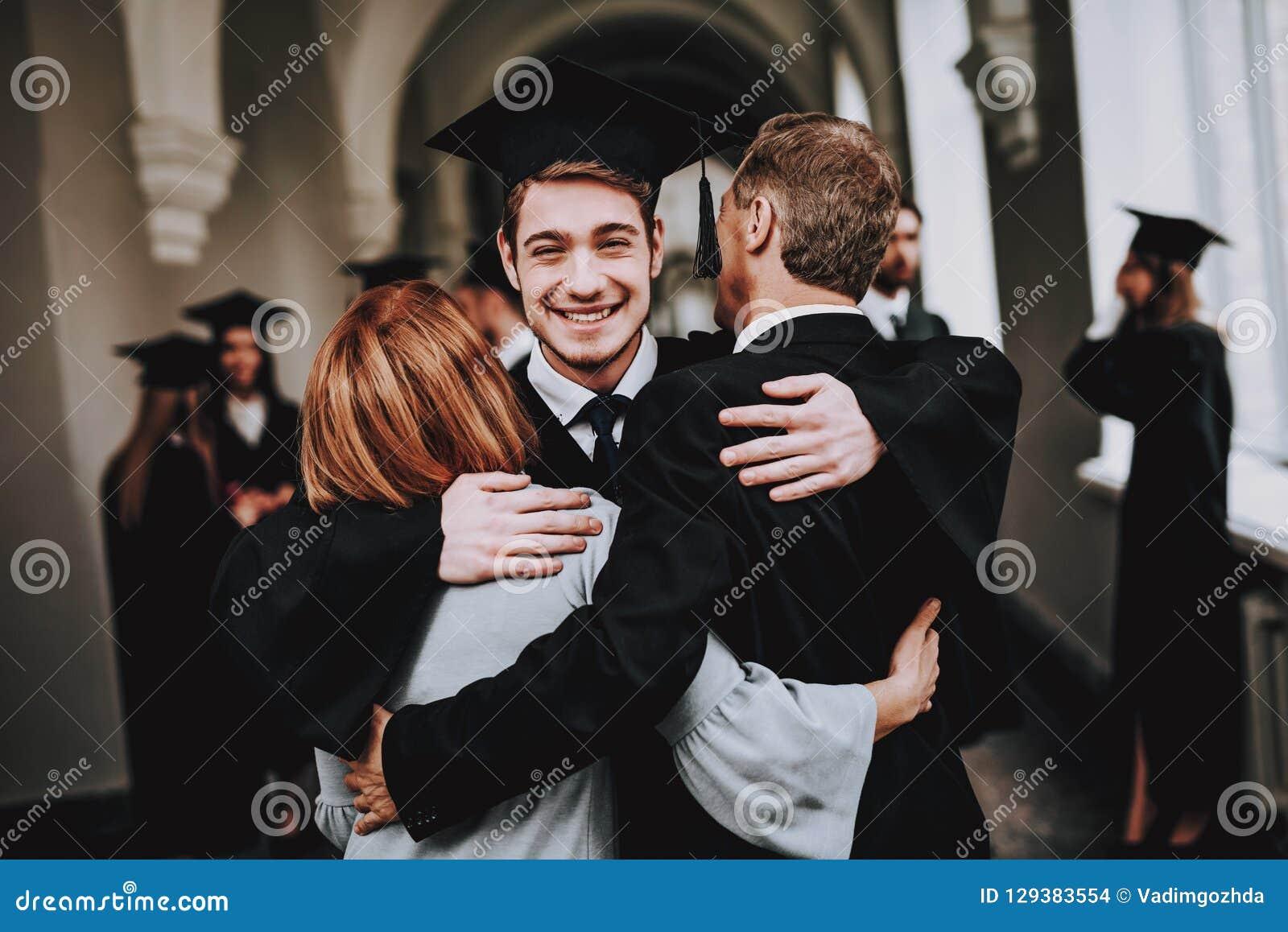 Mother. Father. Son. Hugs. University. Graduates.