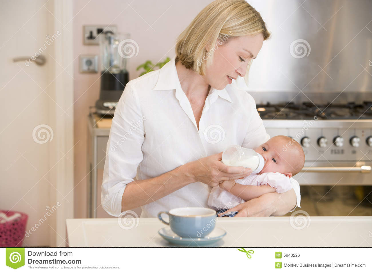 Mother With Baby In Kitchen Stock Image 31458661