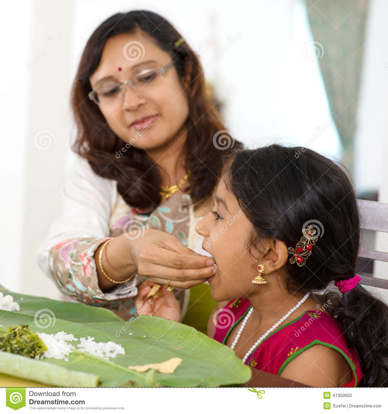 Indian Family Dining At Home Candid Photo Of Asian Mother Feeding Rice To Child With Hand India Culture