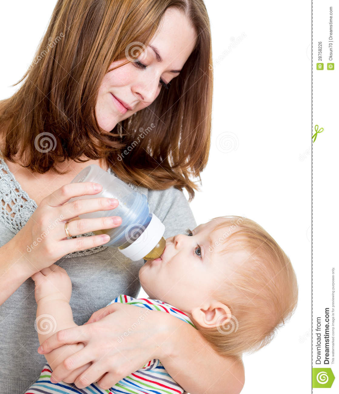 Mother Feeding Her Cute Baby Boy From Bottle Royalty Free