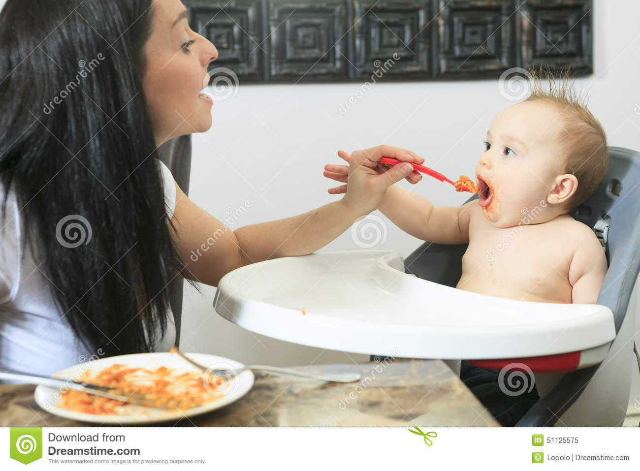 Mother Feeding Hungry Six Month Old Baby Solid Stock Image ...